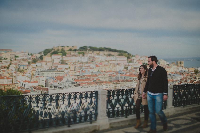 couple walking on Miradouro de São Pedro de Alcântara