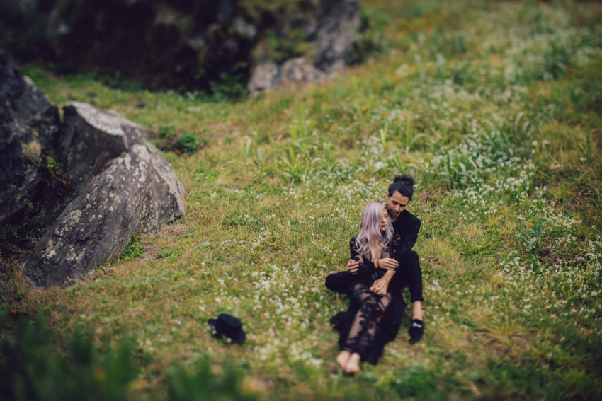 couple hugging on grassy hill