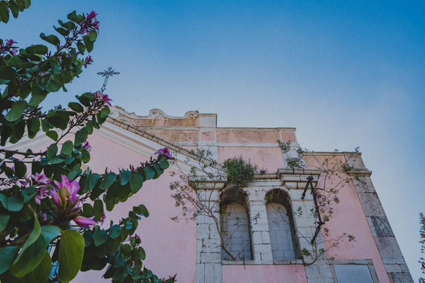 pink church below the castle