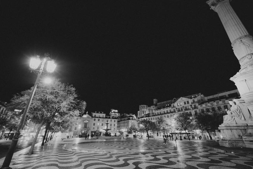 Praça Dom Pedro IV at night in black and white