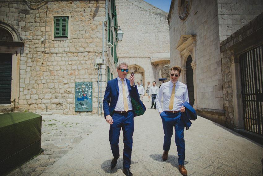 groom and best man walking from Ploče gate
