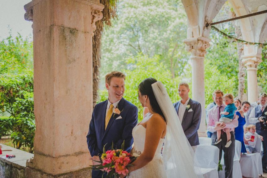 bride and groom exchange glances