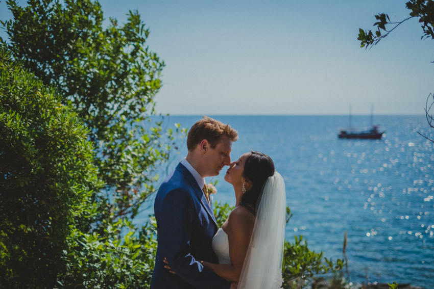 bride and groom kissing near the Adriatic sea