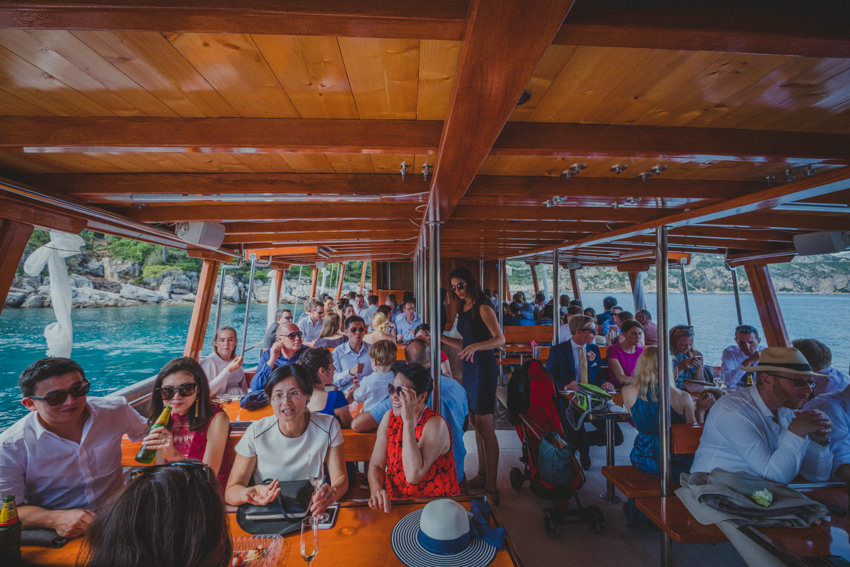 all the guests on the boat, wide shot