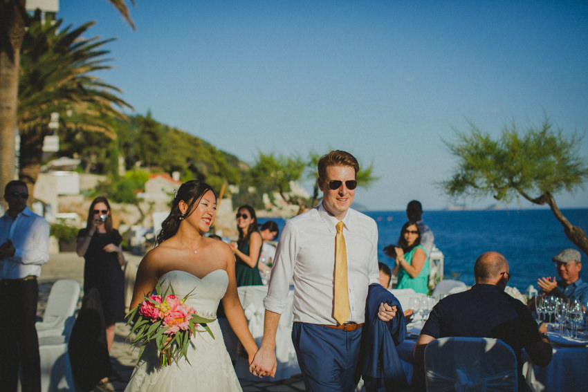 bride and groom entering reception venue on Palm Terrace close up