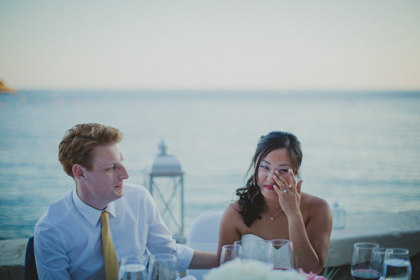 bride drying her eyes during the speech