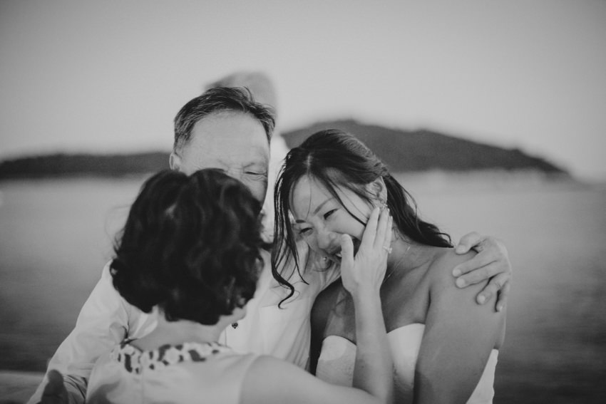 bride hugging her parents