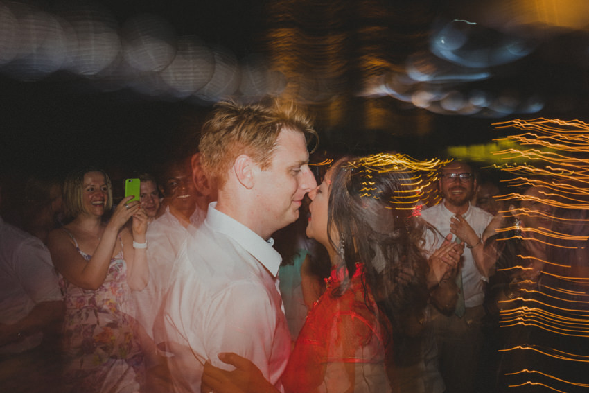 newlyweds dancing with guests
