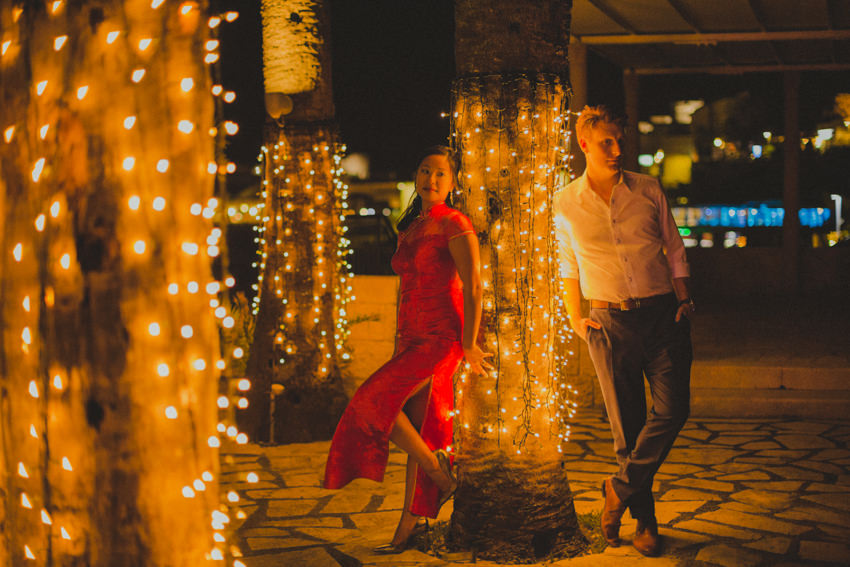 bride in a bright red chinese dress and groom on Palm Terrace