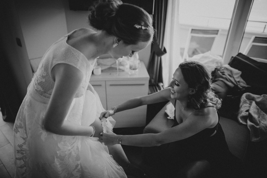bride putting on the garter