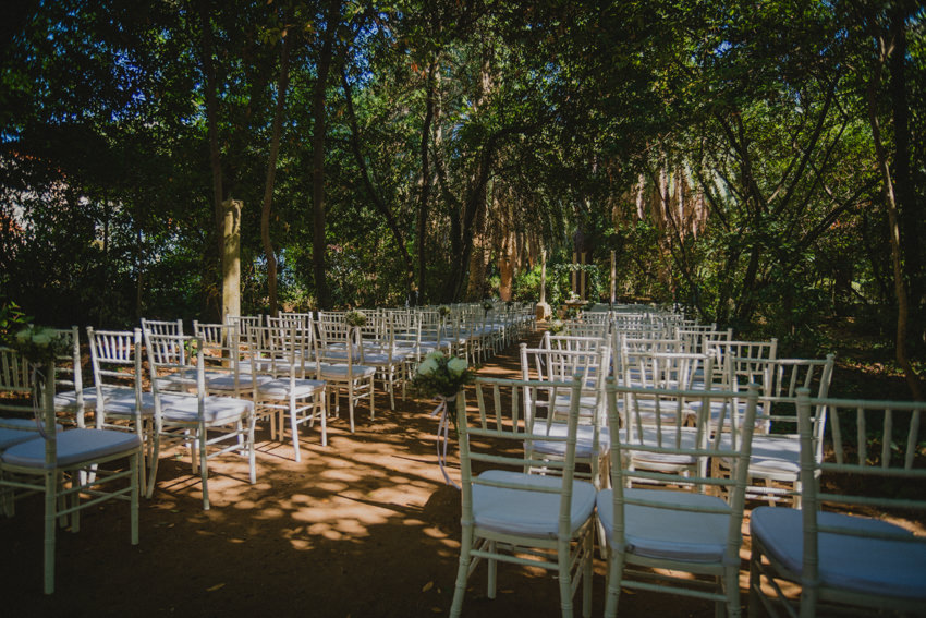 botanical garden for ceremony with chairs