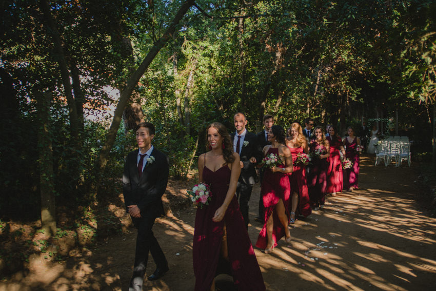 bridesmaids and groomsmen leaving