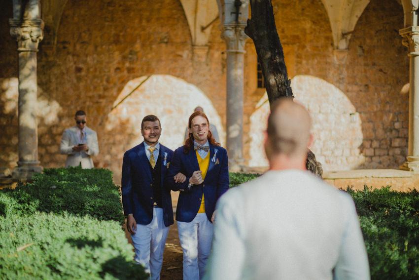 grooms walking down the aisle