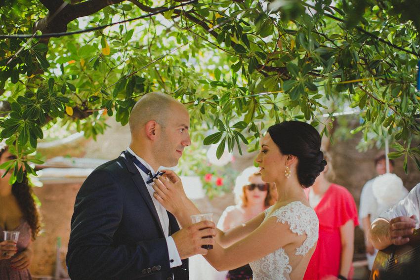 bride fixing up groom's bow tie