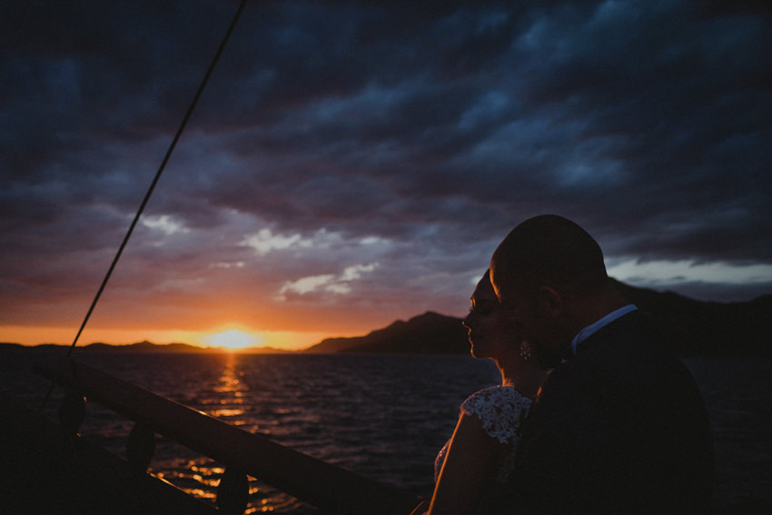 newlyweds on Karaka at sunset