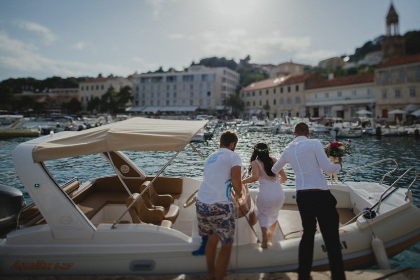 newlyweds boarding a speedboat in Hvar harbor
