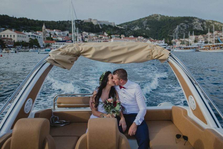 couple kissing while sailing off the coast of Hvar