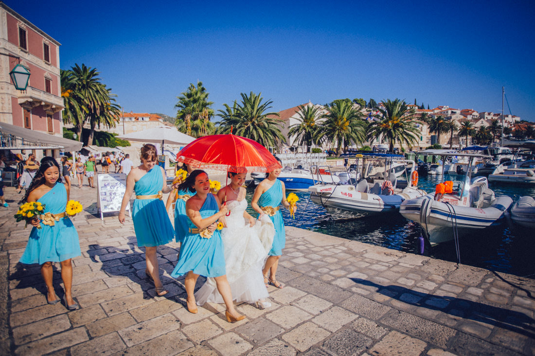 bride with bridesmaids walking through hvar