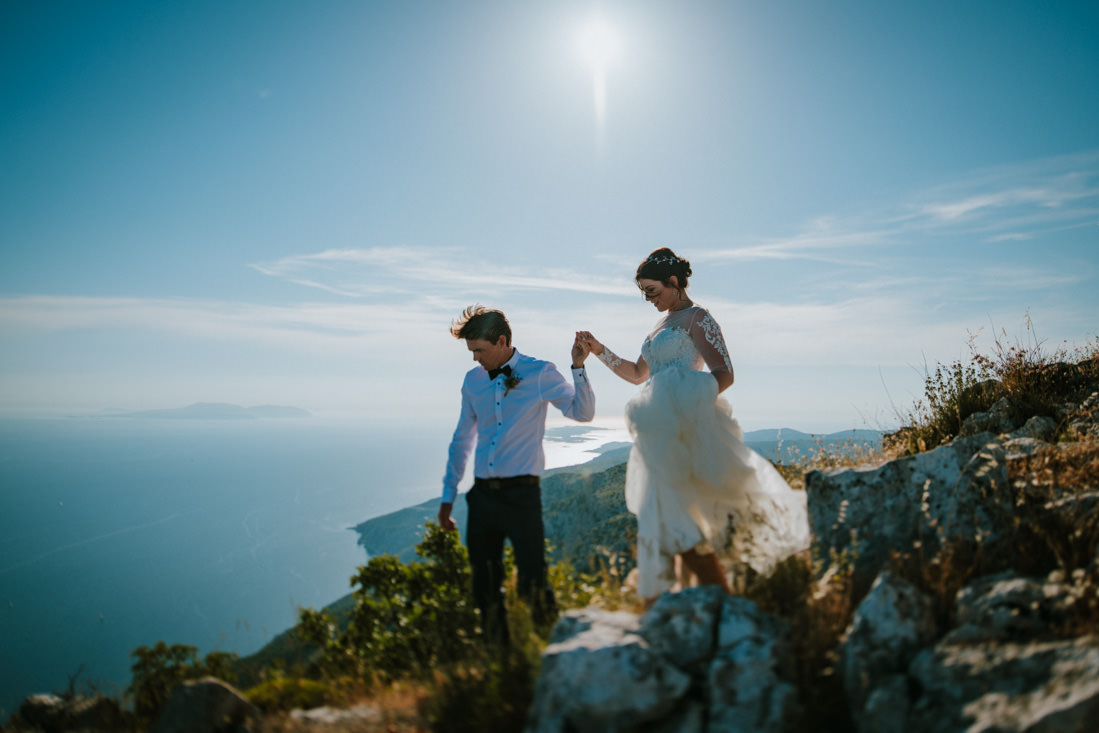 couple walking on hvar mountains