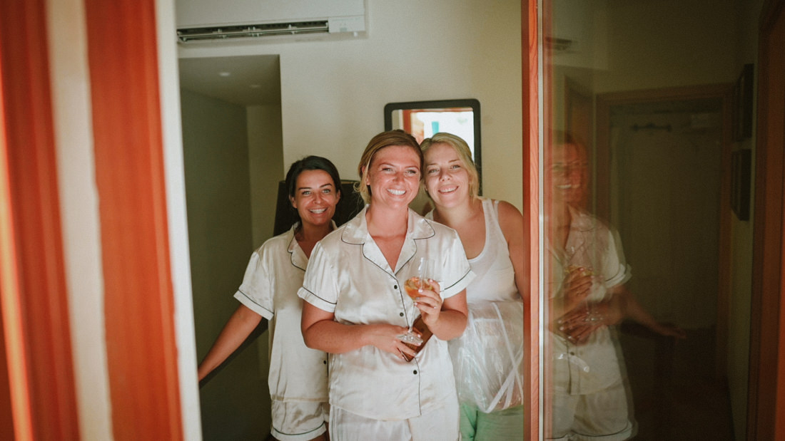 bridesmaids looking the bride