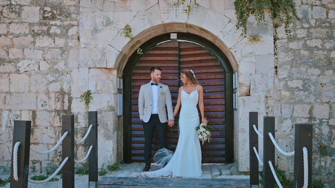 couple in front of main entrance