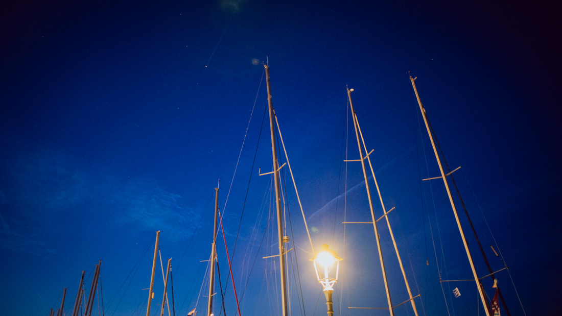 sailboats at night